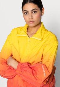 Calvin Klein Jeans - WINDBREAKER - Bomber Jacket - yellow - 3