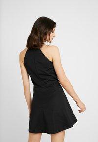 NA-KD - PAMELA REIF X  NA-KD HALTER NECK SKATER DRESS - Vestito di maglina - black - 3