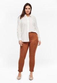 Triangle - Leggings - Trousers - cognac - 1
