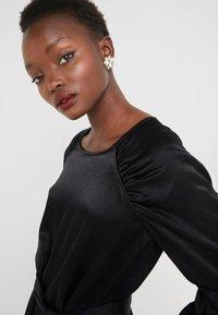 Bruuns Bazaar - PHILOSOPHY NILE DRESS - Koktejlové šaty/ šaty na párty - black - 4