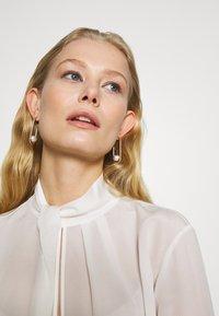 Swarovski - SO COOL - Earrings - silver-coloured - 1