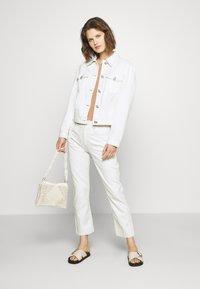 Custommade - YUKI PANTS - Straight leg jeans - whisper white - 1