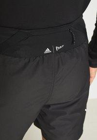 adidas Performance - AGRAVIC SHORT 2-IN-1  - Sports shorts - black/white - 5
