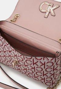 Calvin Klein - RE LOCK CROSSBODY - Across body bag - pink - 2