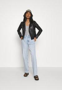 Vero Moda - VMHOPE COATED JACKET - Faux leather jacket - black - 1