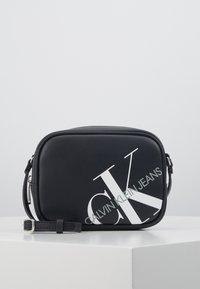 Calvin Klein Jeans - CAMERA BAG - Across body bag - black - 1
