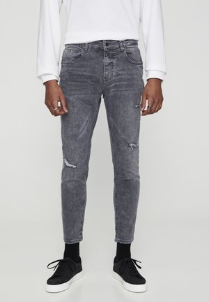 Skinny džíny - mottled dark grey