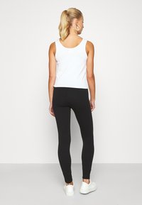 Hollister Co. - TIMELESS - Tracksuit bottoms - black - 2