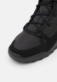 adidas Performance - TERREX CHOLEAH PADDED RAIN.RDY - Winter boots - core black/grey five - 5