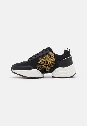 CAGED RUNNER TIGER - Sneakers basse - black/gold