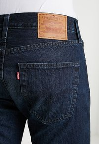 Levi's® - 501® SLIM TAPER - Jeans Tapered Fit - deep and dark - 5