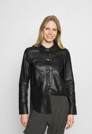 ANAE - Leather jacket - black