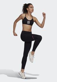 adidas Performance - HOW WE DO LONG LEGGINGS - Tights - black - 1