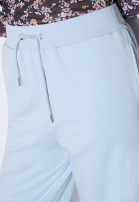 ORSAY - Tracksuit bottoms - light blue - 2