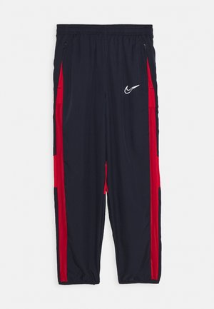 DRY ACADEMY  - Tracksuit bottoms - obsidian/university red/white