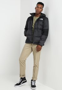 The North Face - HIMALAYAN LIGHT HOODIE - Down jacket - black - 1
