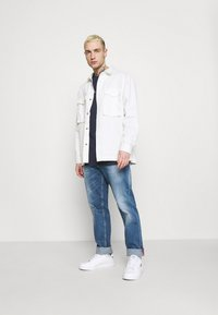 Tommy Jeans - LOGO TEE UNISEX - Långärmad tröja - twilight navy - 1