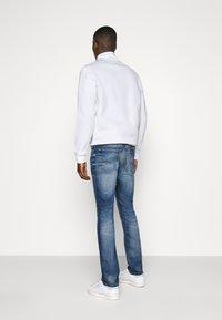 Tommy Jeans - SCANTON - Slim fit -farkut - light blue denim - 2