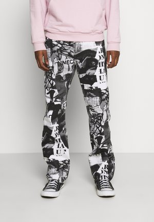 SPACE PAPER COLLAGE TROUSERS - Džíny Relaxed Fit - black
