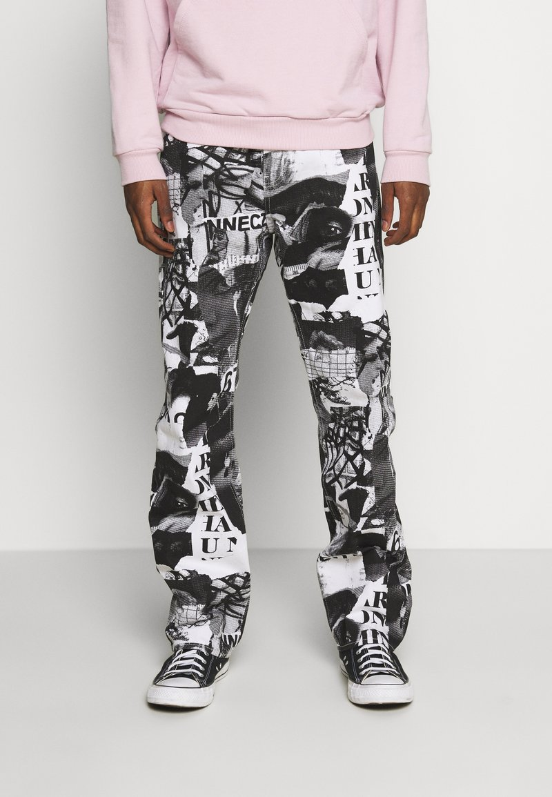 Weekday - SPACE PAPER COLLAGE TROUSERS - Jeans baggy - black