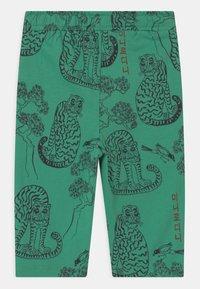 Mini Rodini - TIGERS UNISEX - Trousers - green - 1