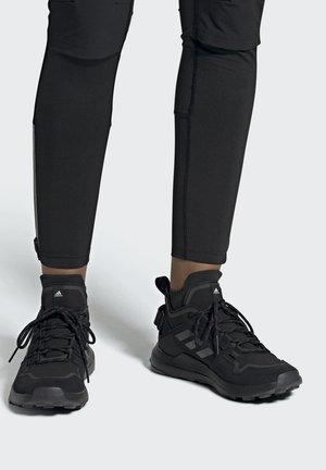 TERREX URBAN TRAXION MID - Sneakers - black