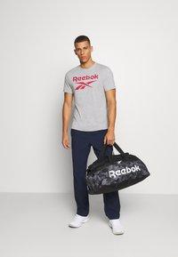 Reebok - ACT CORE GRIP UNISEX - Sports bag - black - 0