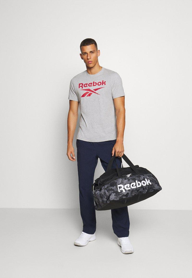 Reebok - ACT CORE GRIP UNISEX - Sports bag - black