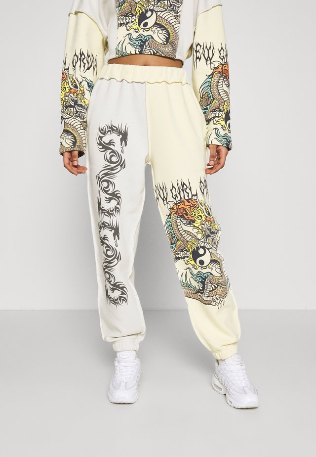 YIN YANG DRAGON PANEL - Tracksuit bottoms - cream