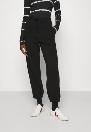 RUBI PANTS - Tracksuit bottoms - black