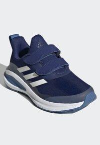 adidas Performance - FORTARUN - Stabilty running shoes - blue - 1
