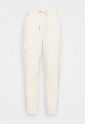REESE - Tracksuit bottoms - beige