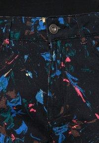 Desigual - PANT SPLATTER - Slim fit jeans - black - 4