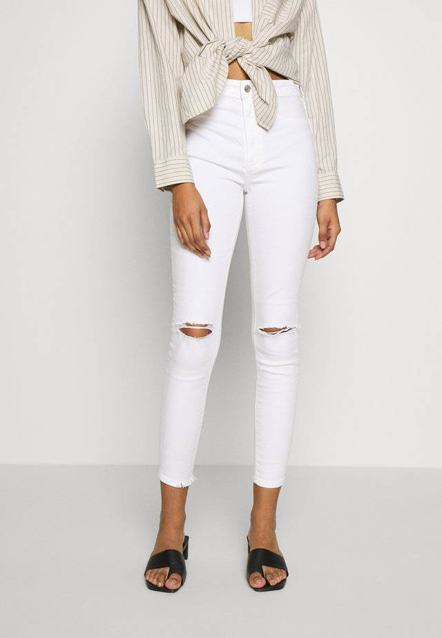 SUPER HI-RISE - Jeansy Skinny Fit - white out