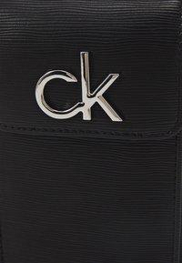 Calvin Klein - PHONE XBODY POUCH - Across body bag - black - 4