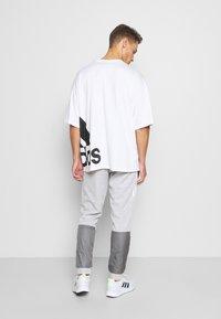 adidas Performance - MUST HAVES AEROREADY SPORTS REGULAR PANTS - Tracksuit bottoms - mottled dark grey - 2