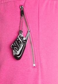 Nike Sportswear - AIR PANT   - Tracksuit bottoms - pinksicle/black - 5