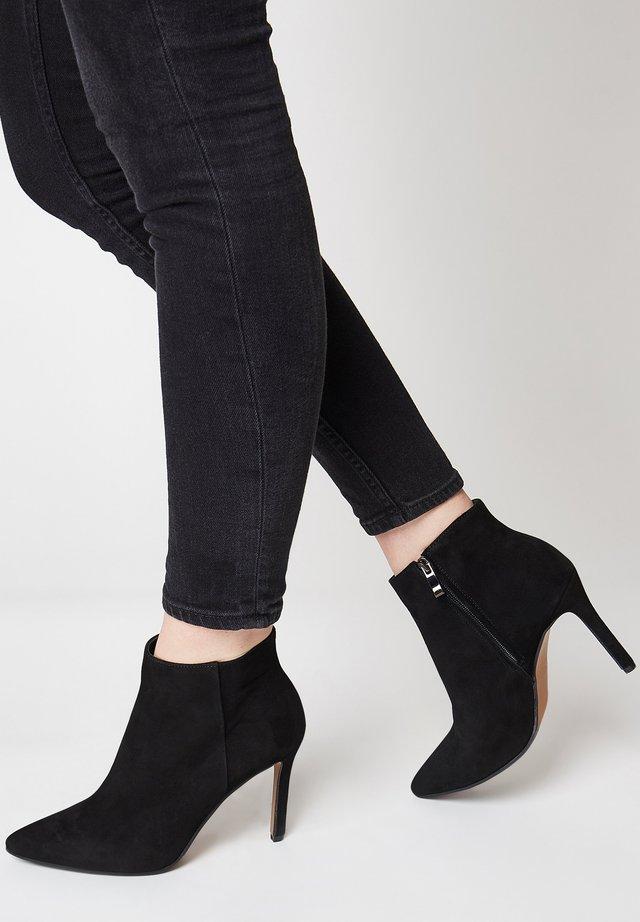 Ankle boots - schwarz velour