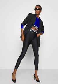 Versace Jeans Couture - PANTS - Leggings - Trousers - black - 7