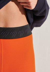 Superdry - Leggings - Trousers - bold orange - 2