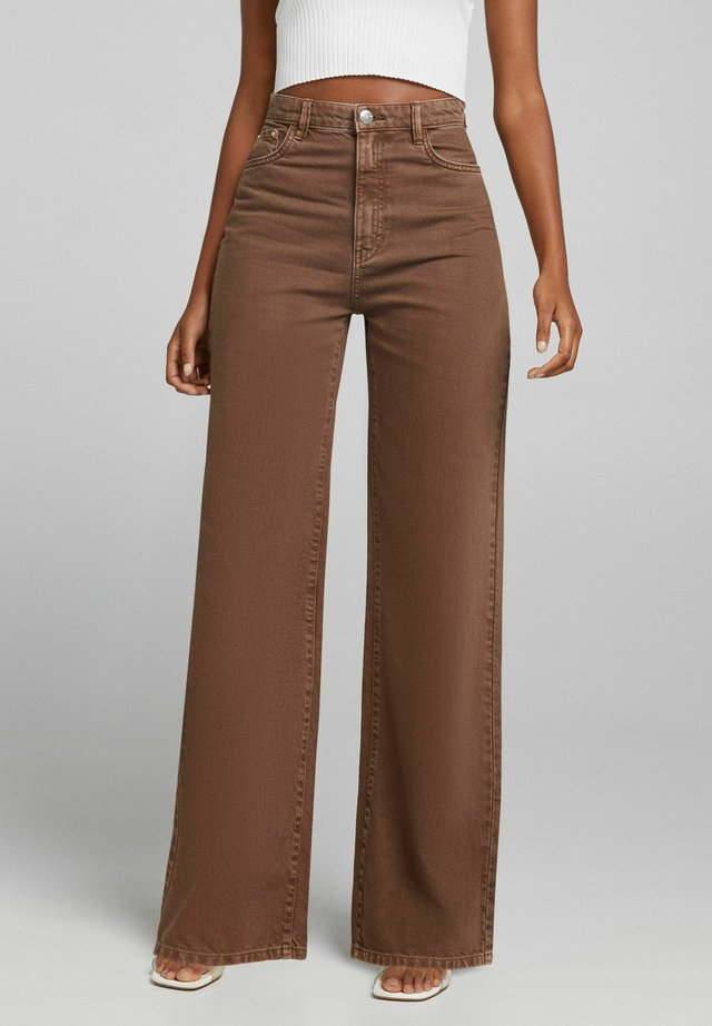 WIDE LEG - Flared Jeans - brown