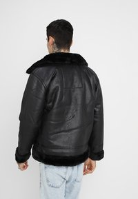 Alpha Industries - Faux leather jacket - black - 2