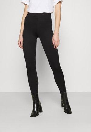 JOSIESTIRRUP - Leggings - Trousers - black