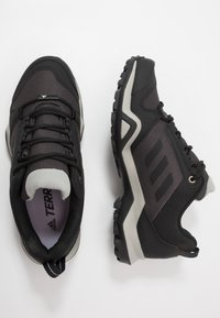 adidas Performance - TERREX AX3 - Hiking shoes - dough solid grey/core black/purple tint