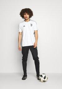 adidas Performance - TIRO  - Spodnie treningowe - black - 1