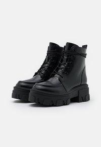 The Kooples - BOTTINE AVEC GROSSE SEMELLE - Platform ankle boots - black - 2