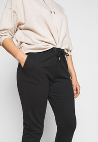 Anna Field Curvy - Tracksuit bottoms - black - 4