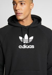 adidas Originals - ADICOLOR PREMIUM TREFOIL HODDIE SWEAT - Bluza z kapturem - black - 4