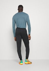 Nike Performance - ELITE PANT - Tracksuit bottoms - black/reflective silver - 2