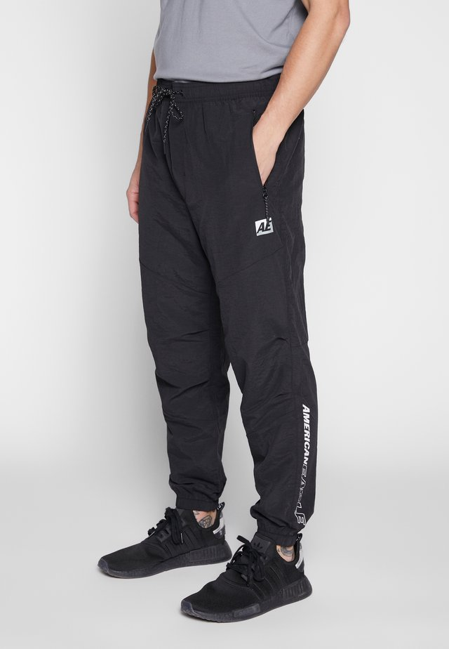 CORE JOGGER - Tracksuit bottoms - black